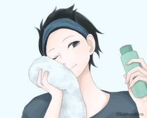 タオルで顔を拭く男性