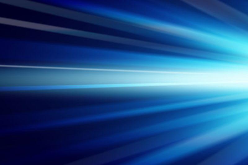 暗い空間に右から放たれている光線